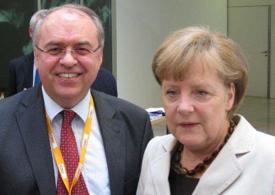Dr. Burkhard Budde und Angela Merkel